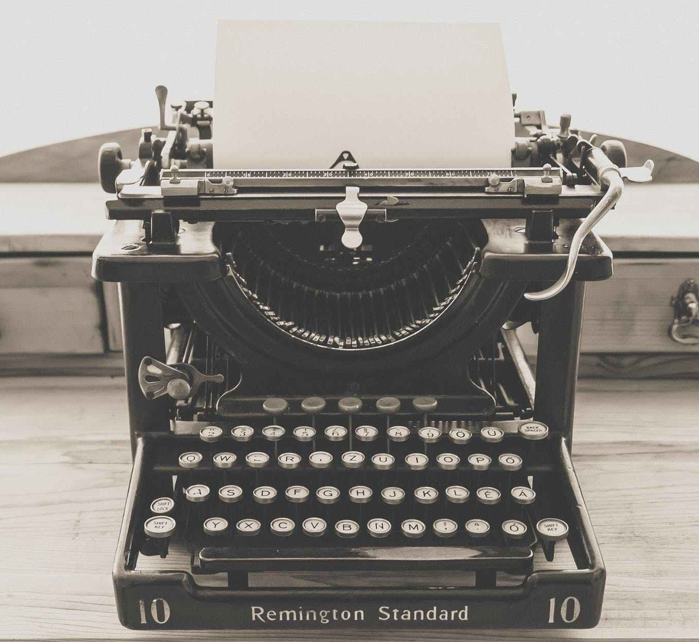 remington standard typewriter in greyscale photography